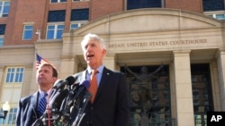 FILE - Virginia Attorney General Mark Herring, right, accompanied by Virginia Solicitor General Stuart Raphael, speaks outside the federal courthouse in Alexandria, Va., Friday, Feb. 10, 2017, following a hearing on President Donald Trump's travel ban.