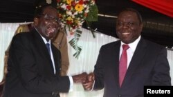 FILE: President Robert Mugabe and Prime Minister Morgan Tsvangirai at the constitution signing ceremony.