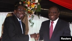 President Robert Mugabe and Prime Minister Morgan Tsvangirai at the constitution signing ceremony