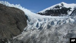 This April 19, 2013, file photo shows the Mendenhall Glaicer in Juneau, Alaska. More than two-thirds of the recent rapid melting of the world's glaciers can be blamed on humans. (AP Photo/Becky Bohrer, File)