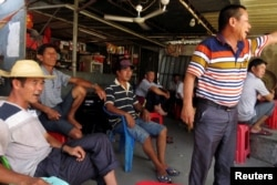 Villagers gather to discuss the recent arrest of their democratically elected village chief Lin Zulian, in the southern Chinese fishing village of Wukan, June 20, 2016.