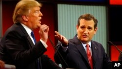 Republican presidential candidates, businessman Donald Trump and Sen. Ted Cruz, R-Texas, argue a point during a Republican presidential primary debate at Fox Theatre, Thursday, March 3, 2016.