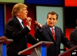 FILE - Republican presidential candidates, businessman Donald Trump and Sen. Ted Cruz, R-Texas, argue a point during a Republican presidential primary debate at Fox Theatre, March 3, 2016.