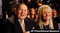 Sheldon Adelson sits with his wife Miriam waits for the presidential debate between Democratic presidential nominee Hillary Clinton and then-Republican presidential nominee Donald Trump at Hofstra University in Hempstead, N.Y., Monday, Sept. 26, 2016.