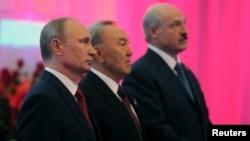 From left: Russian President Vladimir Putin, Kazakh President Nursultan Nazarbayev, and Belarus President Alexander Lukashenko before meeting of Eurasian Economic Union, Astana, Kazakhstan, May 29, 2014.