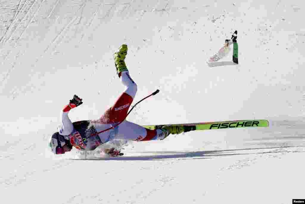 Switzerland's Urs Kryenbuehl crashes at the finish line during an alpine ski, men's World Cup downhill in Kitzbühel, Austria.