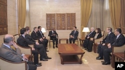Syria's President Bashar al-Assad (center R) meets U.N.-Arab League envoy Kofi Annan (center L) in Damascus March 10, 2012.