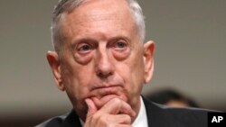 FILE - Defense Secretary Jim Mattis listens while testifying on Capitol Hill in Washington, June 13, 2017, before a Senate Armed Services Committee hearing on the defense department's budget.