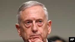 Defense Secretary Jim Mattis listens while testifying on Capitol Hill in Washington.