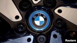 FILE PHOTO: The BMW logo is seen on the wheel of a vehicle presented at the Auto China 2016 auto show in Beijing, April 29, 2016.