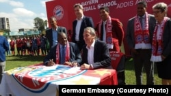 German champion football club Bayern Munich has signed an agreement to open its first soccer school in Africa, locating it in Addis Ababa, Ethiopia. European Football Federation President Esayas Jira, seated at left, and FC Bayern Munich AG executive boar