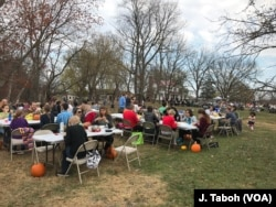 Visitors enjoy a vegan pot-luck picnic with the free-roaming turkeys at Poplar Spring Animal Sanctuary in Poolesville, Maryland.