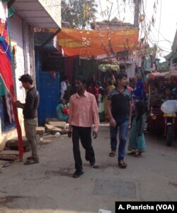 Most people in this slum in East Delhi continue with the practice of open defecation because of long waiting lines at the community toilet.