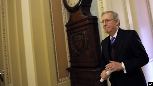 Senate Minority Leader Mitch McConnell of Ky. walks to the Senate floor on Capitol Hill in Washington, Thursday, Dec. 27, 2012.