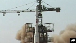 In this April 5, 2009 image made from KRT video, a rocket is lifted off from its launch pad in Musudan-ri, North Korea. North Korea announced Friday, March 16, 2012, it plans to launch a long-range rocket mounted with a satellite next month.