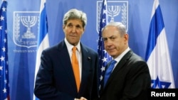 FILE - U.S. Secretary of State John Kerry meets with Israeli Prime Minister Benjamin Netanyahu in Tel Aviv, July 23, 2014.