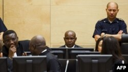 FILE - Congolese ex-militia boss Mathieu Ngudjolo (C) waits for the verdict on his trial at the International Criminal Court in The Hague, December 18, 2012.