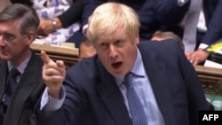 A video grab from footage broadcast by the UK Parliament's Parliamentary Recording Unit (PRU) shows Britain's Prime Minister Boris Johnson speaking during his first Prime Ministers Questions session in the House of Commons in London on September 4, 2019.