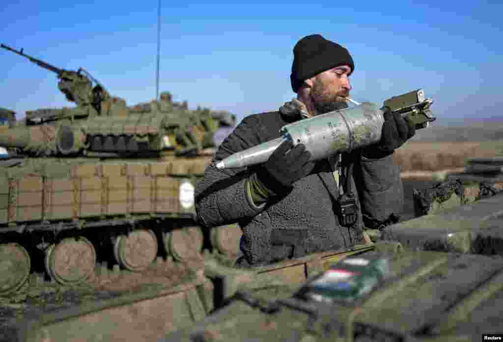 A Ukrainian serviceman loads ammunition into a tank in the territory controlled by Ukraine's government forces, in the Donetsk region, Feb. 13, 2015.