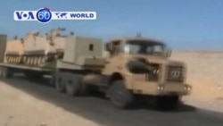 Egyptian troops move into the town of Al-Arish after a series of attacks on security forces