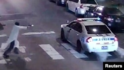 A still image from surveillance video shows a gunman approaching a Philadelphia police vehicle in which Officer Jesse Hartnett was shot shortly before midnight Jan. 7, 2016, in Philadelphia, Pennsylvania.