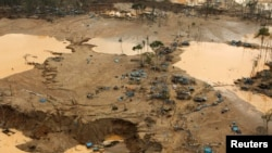 FILE- An area deforested by illegal gold mining is seen in a zone known as Mega 13, at the southern Amazon region of Madre de Dios, Jan. 25, 2014.
