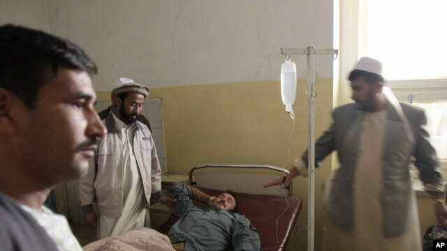 An Afghan police officer who was wounded in a suicide bombing lies in a hospital bed in Baghlan, Afghanistan, November 6, 2011.