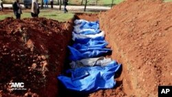 A mass burial of people allegedly killed by Syrian Army snipers, in Al. (File)