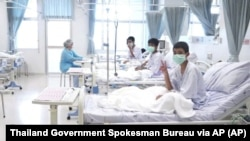 In this photo taken from a video released by the Thailand government, three of the 12 boys are seen recovering in their hospital beds after being rescued along with their coach from a flooded cave in northern Thailand.