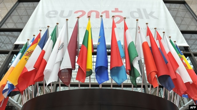 European flags are displayed outside the great hall of the Brussels European Council on June 27, 2012.