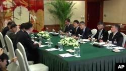 Quan chức Hội Chữ Thập Đỏ của Nhật Bản và Bắc Triều Tiên họp tại Thẩm Dương, Trung Quốc, ngày 3/3/2014.