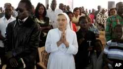 Christian worshippers pray during Christmas mass at a Church in Khartoum, Sudan, Dec. 25, 2013.