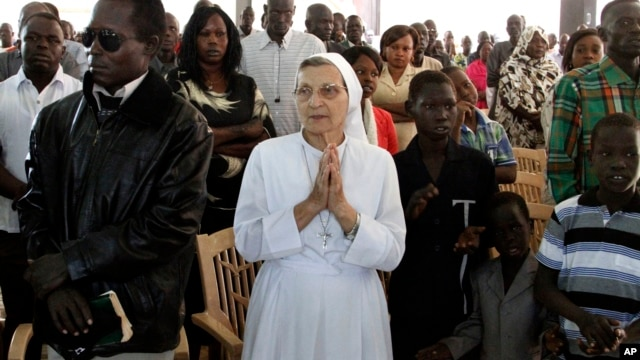 Christian worshipers pray during Christmas mass at a Church in Khartoum, Sudan, Dec. 25, 2013.
