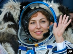"U.S. space tourist Anousheh Ansari waves shortly after landing in northern Kazakhstan.""I just love that feeling of freedom that you get from being in space, and I certainly got addicted to it,"" she told AP after landing. Photo taken Sept. 29, 2006 (AP Photo)"