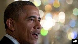 El presidente Obama hablando durante una conferencia de prensa en la Casa Blanca, este viernes, para anunciar iniciativa sobre salud.