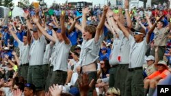 Boy Scouts sing and dance to music as they await the arrival of President Donald Trump at the 2017 National Boy Scout Jamboree at the Summit in Glen Jean, W.Va., July 24, 2017.