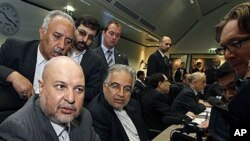 Iran's Minister of Petroleum Masoud Mir-Kazemi, left, speaks to journalists prior to the start of the meeting of the Organization of the Petroleum Exporting Countries at their headquarters in Vienna, Austria, 14 Oct 2010