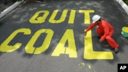 FILE - Activists protest the use of coal in the Philippines, June 3, 2008. Decreasing the world's reliance on coal and other fossil fuels is key to global health, said participants Thursday at the World Climate Summit in Washington.
