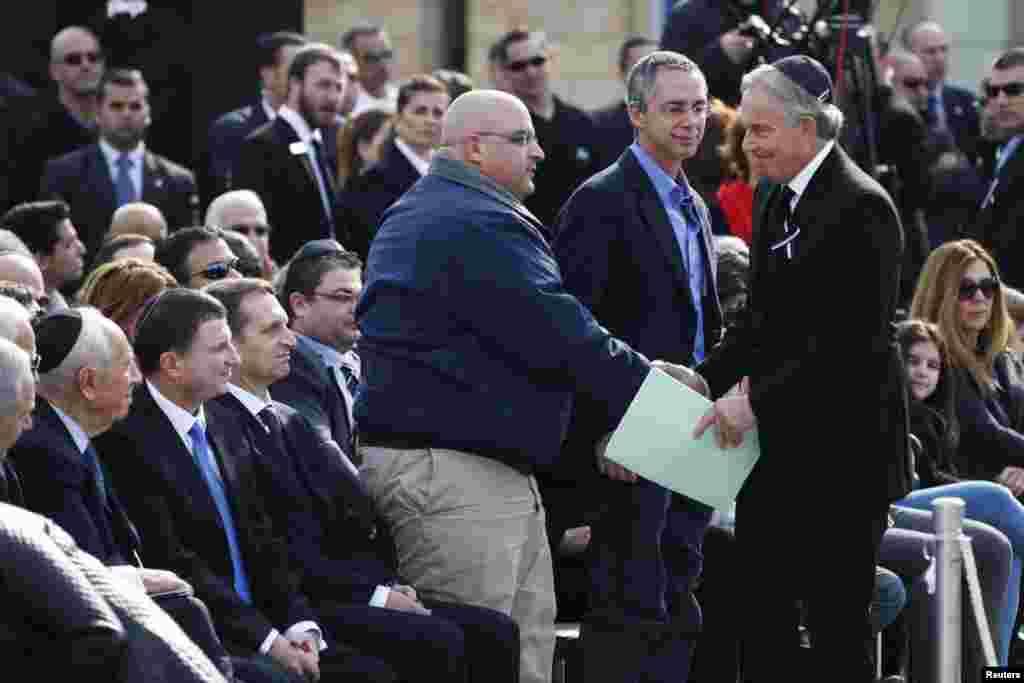 Спецпосланник ООН на Ближнем Востоке Тони Блэр и сыновья бывшего премьер министра Израиля Ариэля Шарона