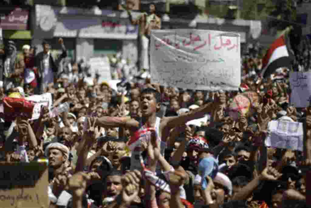 An anti-government protestor, center, reacts during a demonstration demanding the resignation of Yemeni President Ali Abdullah Saleh, in Sanaa, Yemen, Friday, Feb. 25, 2011. Tens of thousands of people gathered in a main square in the Yemeni capital for F