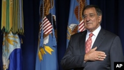Defense Secretary Leon Panetta during the National Anthem at the start of an event at the Pentagon, Friday, Sept. 9, 2011.