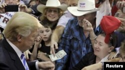 "U.S. Republican presidential candidate Donald Trump, shown campaigning in Richmond, Virginia on Oct. 14, 2015, wrote in his book ""The Art of the Deal"" that ""I play to people's fantasies.''"
