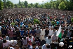 FILE - Kashmiri villagers pray during the funeral of Burhan Wani, chief of operations of Indian Kashmir's largest rebel group Hizbul Mujahideen, in Tral, 38 km south of Srinagar, Indian controlled Kashmir, July 9, 2016.