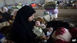 Menurut badan-badan kemanusiaan PBB, masalah serius tentang pangan dan air bersih membuat banyak kamp-kamp pengungsi menjadi tempat berkembang biak berbagai penyakit yang berbahaya (foto: dok).