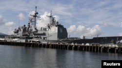 FILE - The USS Shiloh (CG-67) is docked at a port along Subic Bay, north of Manila, Philippines, May 30, 2015.