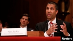 FILE - Ajit Pai, Chairman of the Federal Communications Commission, testifies before a Senate Appropriations Financial Services and General Government Subcommittee on Capitol Hill in Washington, June 20, 2017.
