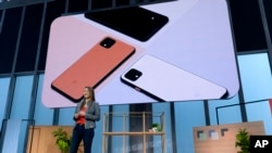 Sabrina Ellis, Vice President Of Product Management at Google, speaks during the announcement of the Pixel 4 (on screen) Tuesday, Oct. 15, 2019, in New York. (AP Photo/Craig Ruttle)