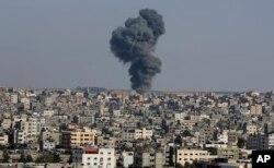 Smoke rises after an Israeli airstrike in Gaza City, the Gaza Strip, Wednesday, May 12, 2021. (AP Photo/Adel Hana)