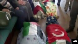 Image made from video provided by TVNET, June 4, 2010, shows bodies shrouded in sheets and flags on board the aid ship Mavi Marmara after a maritime showdown between Israeli commandos and activists on board the ship.