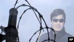 陈光诚遭迫害究竟是地方行为还是中央授意? 图为美国之音中文部制作的陈光诚电视报道视频截屏。